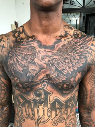 tattoo of an eagle covering a chest