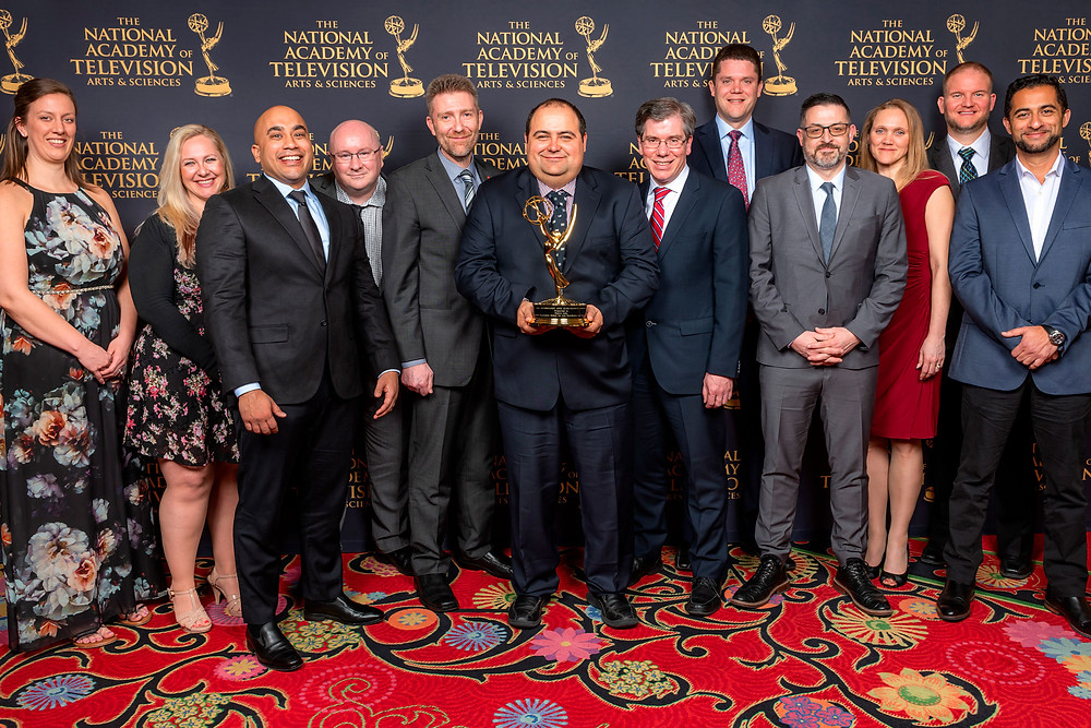 Dejero team accepting the company's first Emmy® at the 70th annual Technology and Engineering Awards in 2019