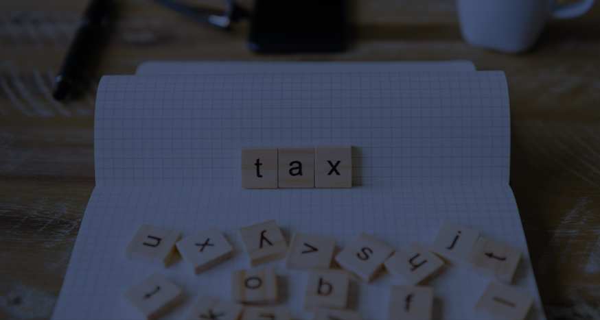 Tax spelt out with tiles on a book