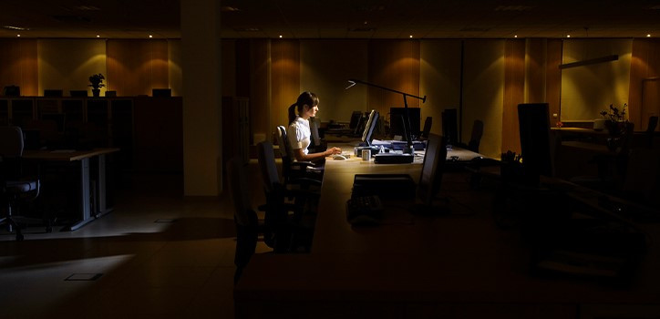 Woman in an office at night