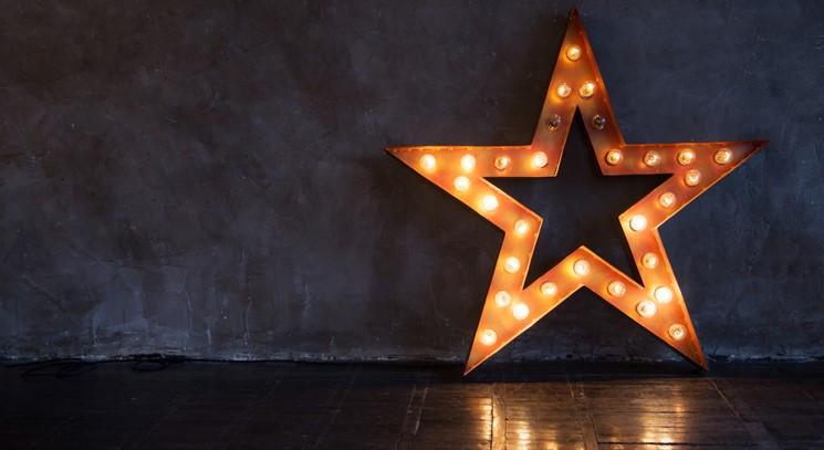 Illuminated star shaped sign
