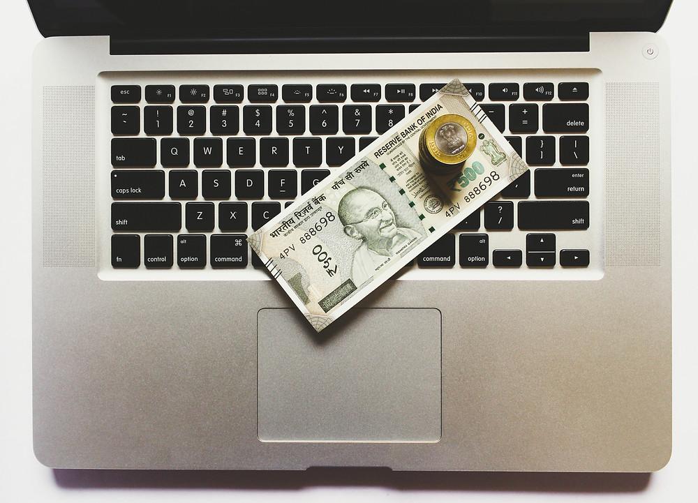 money on laptop