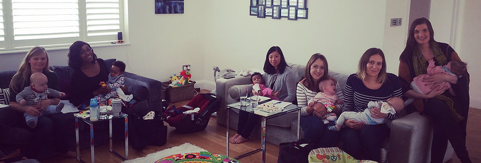 Group of mums with their babies smiling at the camera, baby-led weaning workshop participants