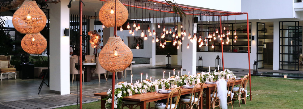 Dining table with rattan lamps.JPG