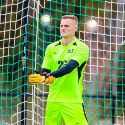 Daniel Kuzemka, NCAA goalkeeper for UNC Charlotte wearing goalkeeper gloves.