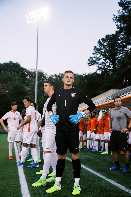 Daniel Kuzemka on the sidelines before an NCAA soccer match.