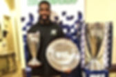 Taking a picture with championship trophies