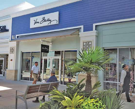 Outlets Boost Sales at Vera Bradley, Michael Kors and Express