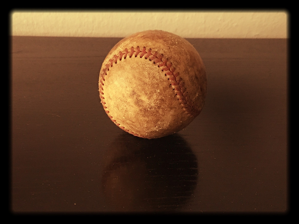 Photo of a well-worn baseball by Paul Amirault