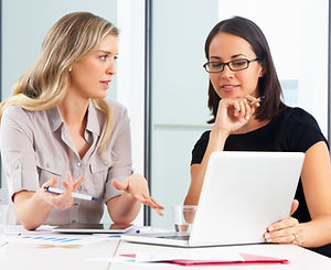 Two Businesswomen Meeting In Office.jpg
