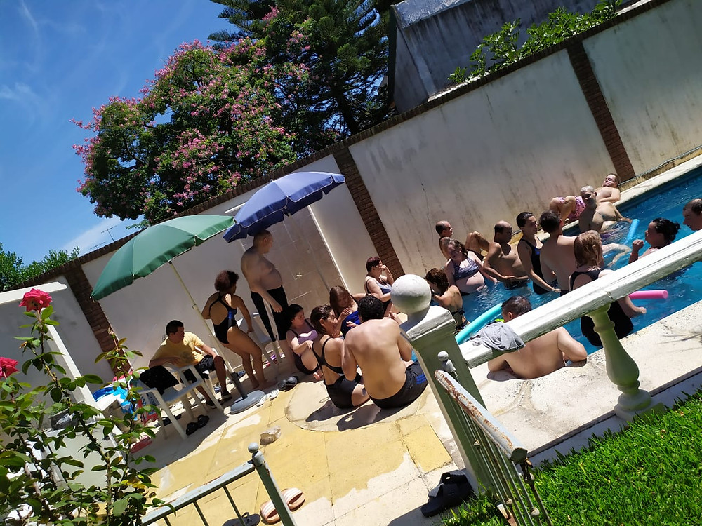 People gathering by the swimming pool