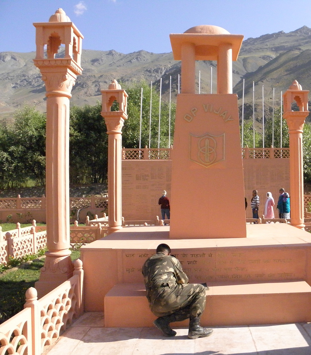 Soldier working on on Inscription, Kargil war memorial