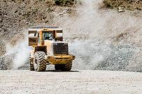wheel-loader-machine-loading-rocks-in-the-open-min-ZD9TNXS.jpg