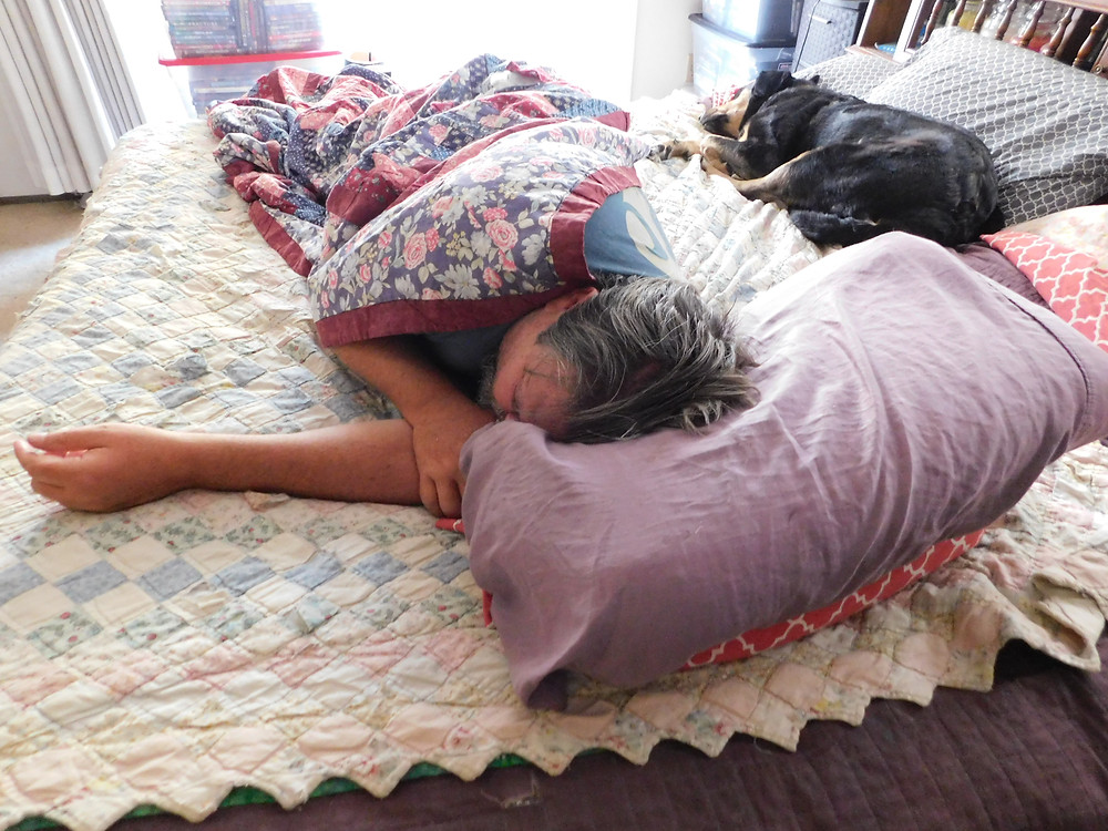 A nap with our Gypsy girl. She does whatever we do.
