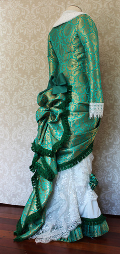 Green and white late Victorian gown