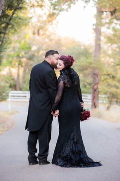 black wedding dress lace and feathers