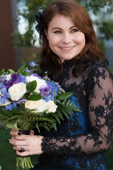 Custom black lace and electric blue satin wedding dress