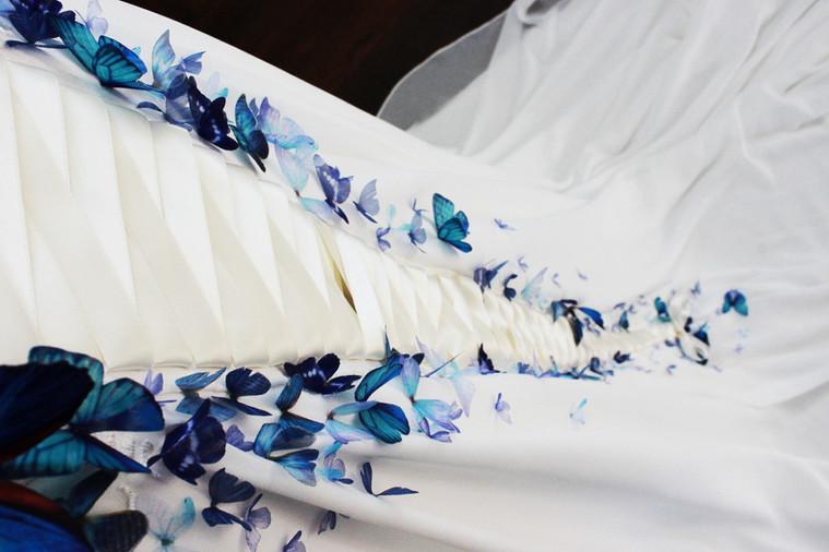 Ivory wedding dress with blue butterflies