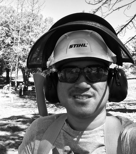 Tran Chainsaw Headshot.jpg