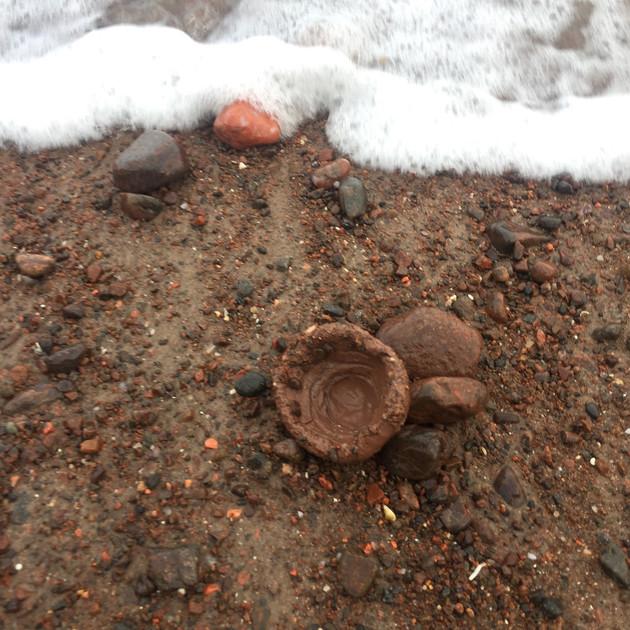 Thumb pot on the shore