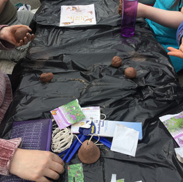Making clay bells with wild flower seeds