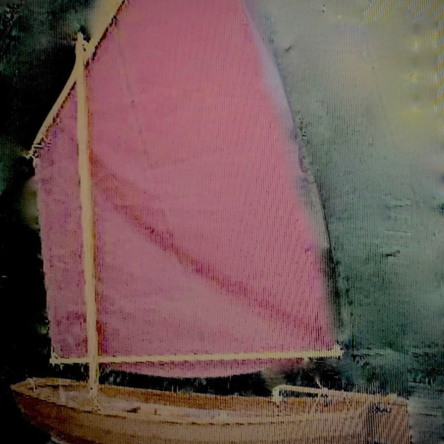 Handmade boat with pink sail