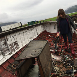 Preparing abandoned boat for art event