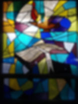 staind glass of Bible at Redeemer
