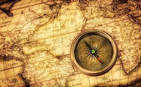 Sepia world map with compass
