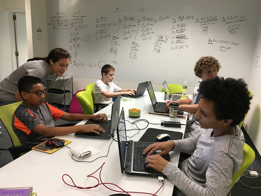 Students learning online together in a physical campus