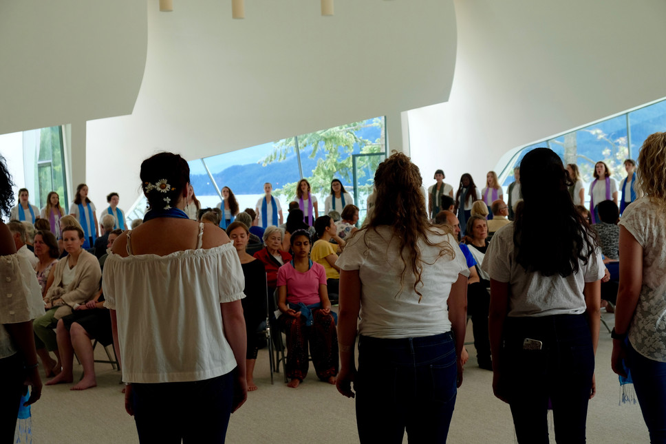 Audience in the middle, singers surrounding them.jpg