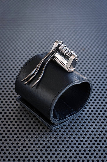 TigerBite. Black Leather cuff with metal details and steel rings