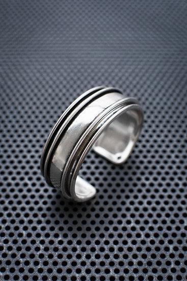 TigerBite. Layered silver plated brass bangle bracelet