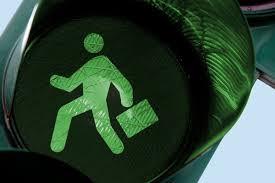 Business man go street light