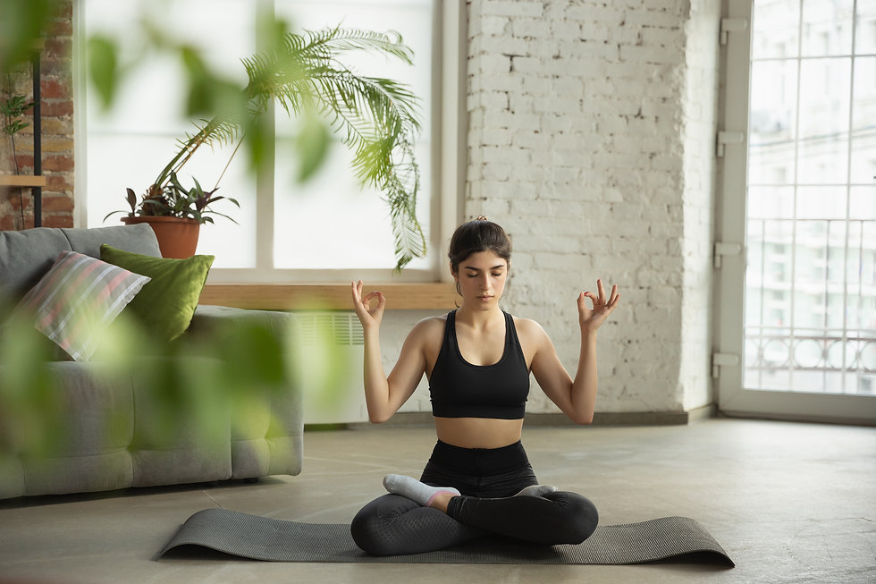 sporty-young-woman-taking-yoga-lessons-o