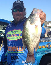 Lee Pitts holding a crappie he caught