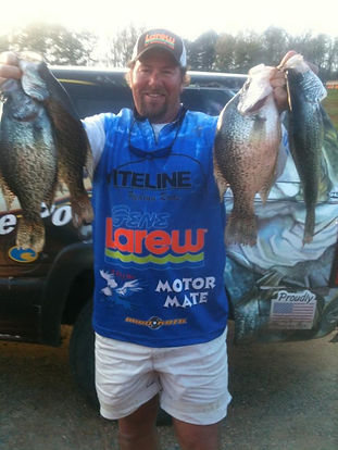 Guide Lee Pitts holding up big crappie