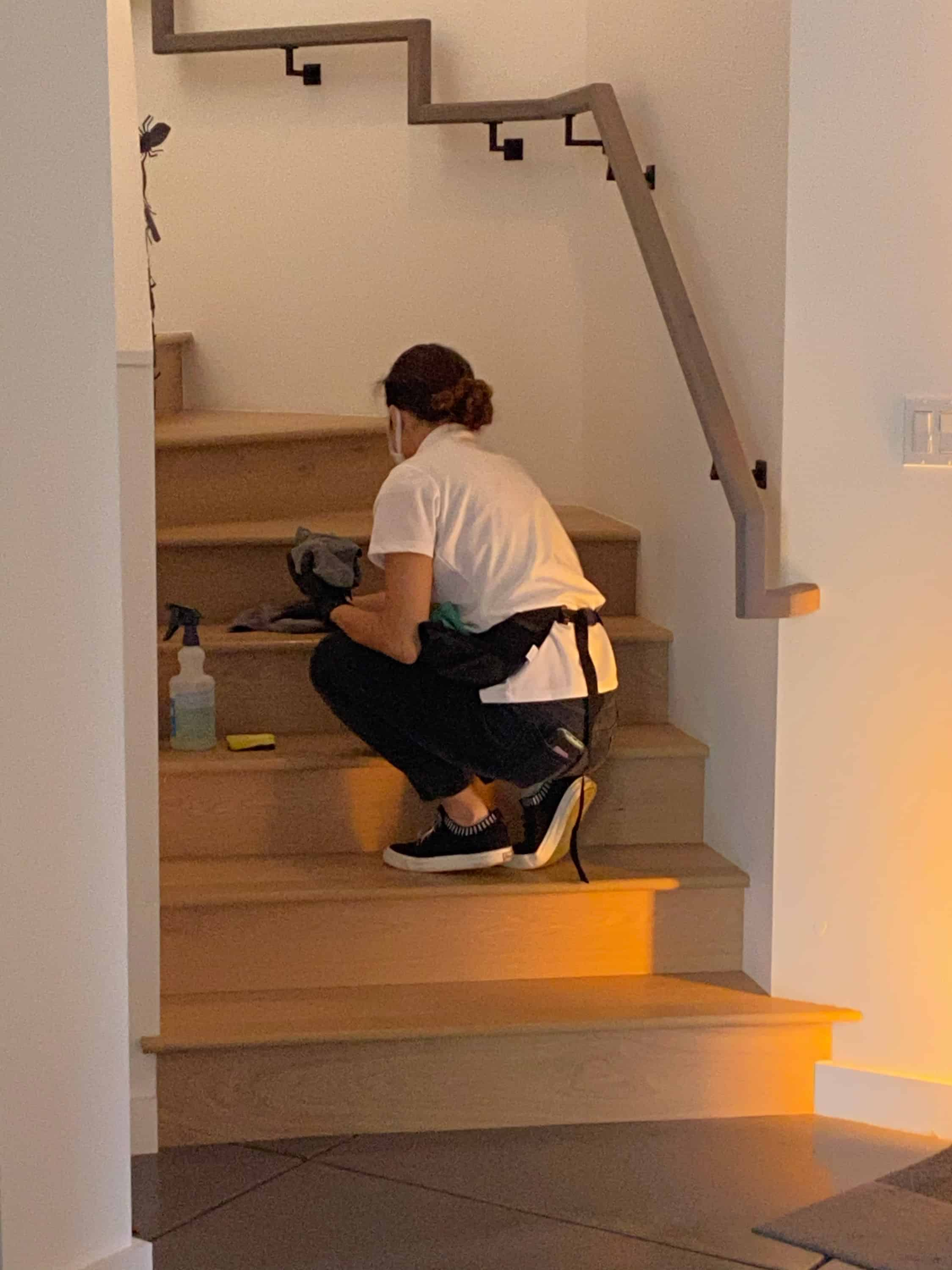 woman cleaner cleaning staircase in a home in Berkeley, California