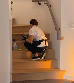 woman cleaner cleaning the steps in home