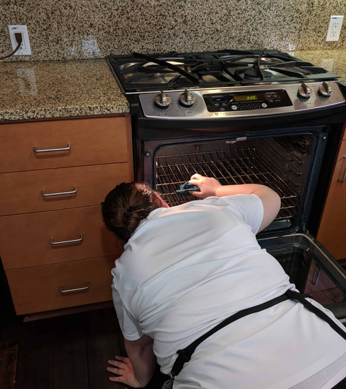 woman cleaner cleaning the inside of an