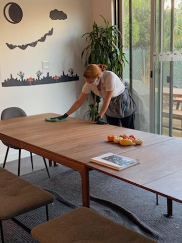 woman cleaner cleaning a kitchen table in a home in Alameda, California