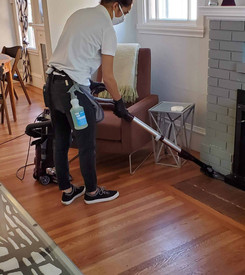 woman cleaner vacuuming the living room