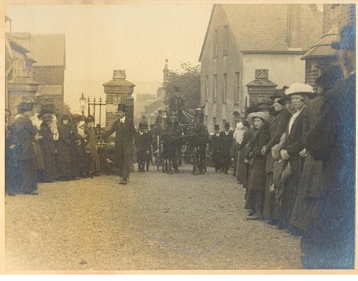 Funeral Director Leading Horse Drawn Funeral Carriage