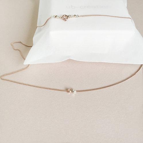 Collier deux perles en argent.