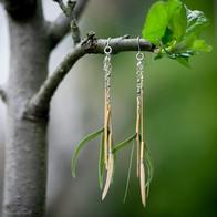 Boucles d'oreilles plumes vertes.