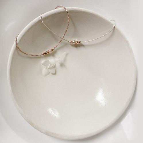 Bracelet perle rose sur soie