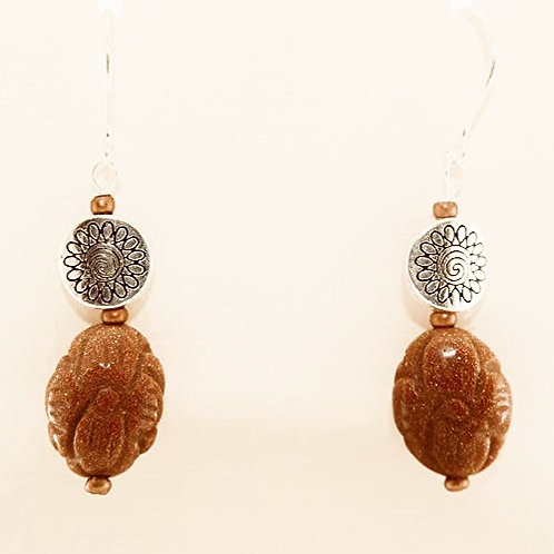 Carved Goldstone oval & rondelles