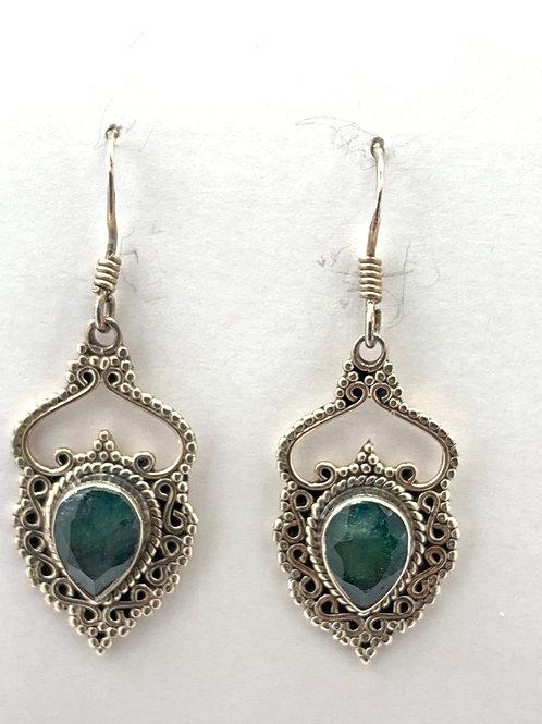 Emerald ornately set in Sterling Silver