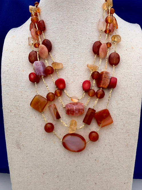 Coral Agate Citrine on brocade cord.