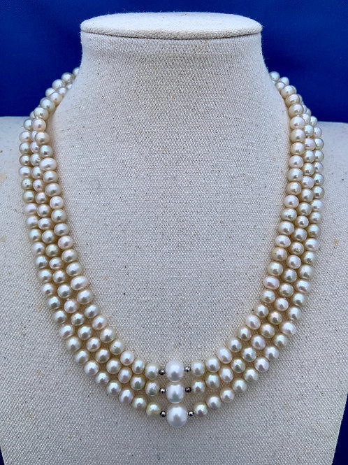 Lustrous round Freshwater Cultured Pearls with Sterling Silver